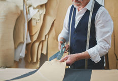 Experienced Old Tailor Working in Small Atelier Royalty Free Stock Photography