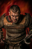 Experienced. Portrait of a courageous ancient warrior in armor royalty free stock photography