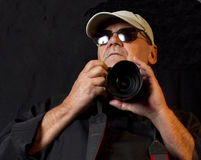 Experienced Professional Photographer. Experienced older male pro photographer in black Stock Photography