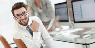 Experienced programmer sitting in front of the monitor. Office work royalty free stock images