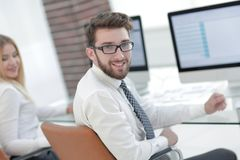 Experienced programmer sitting in front of the monitor. Office work stock images