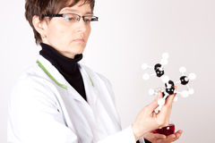 Experienced Scientist. Experienced Doctor holding molecules on white Stock Images