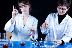 Experienced Scientist and Assistant. Experienced Doctor and Her assistant experimenting in laboratory stock image