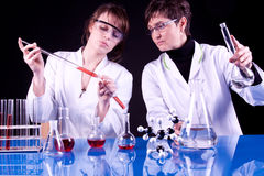 Experienced Scientist and Assistant. Experienced Doctor and Her assistant experimenting in laboratory Royalty Free Stock Photography