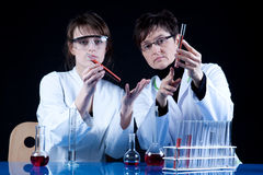 Experienced Scientist and Assistant. Experienced Doctor and Her assistant experimenting in laboratory Stock Photo