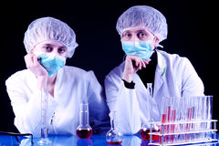 Experienced Scientist and Assistant Stock Images