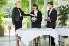 Experienced senior teacher tests students at hotel business school stock images