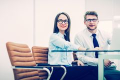 Experienced staff of the company discuss the current problems at the Desk. In the conference room.the photo has a empty space for your text royalty free stock photos