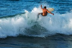 Experienced surfer rides ocean wave. On Oahu`s North Shore, Hawaii stock photos