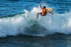 Experienced surfer rides ocean wave stock photos