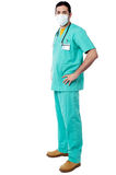 Experienced surgeon with hands on his waist royalty free stock photo