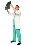 Experienced surgeon looking at patient's x-ray Stock Photography