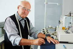Experienced Tailor in His Atelier Studio Royalty Free Stock Images