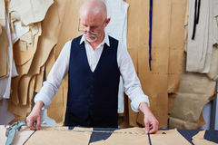 Experienced Tailor Working on Garments in Atelier Stock Photography