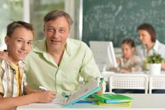 Experienced teachers working with children stock photography
