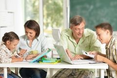 Experienced teachers working with children royalty free stock image