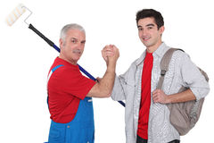 Experienced tradesman with new apprentice. Experienced tradesman making a pact with his new apprentice royalty free stock photos