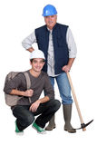 Experienced tradesman. Posing with his new apprentice stock photos