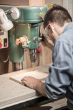 Experienced worker using professional drill Stock Images