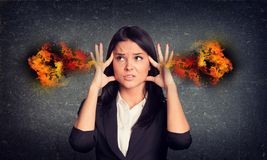 Experiencing woman with fire from ears. Concrete. Concrete gray wall with fissure. Experiencing woman with fire from ears Royalty Free Stock Photo