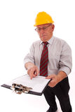 Experient engineer. Experienced engineer looking to the clipboard (isolated on white royalty free stock image