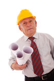 Experient engineer. Experienced engineer holding some blueprints (isolated on white royalty free stock photo