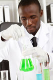 Experiment. African american male scientist doing experiment Stock Image