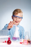 Experiment. An enthusiastic boy looking at the results of his experiment Royalty Free Stock Photos