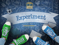 Experiment against blue chalkboard. The word experiment and casual shoes against blue chalkboard stock image