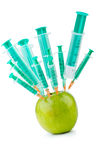 Experiment with apple and syringes Stock Image