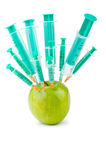 Experiment with apple and syringes Stock Images