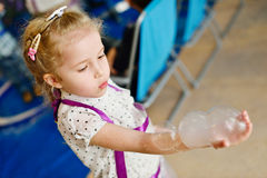 Experiment  with soap bubbles. Experiments with soap bubbles on the birthday party Stock Image
