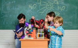 Experimenting together. Supportive environment explore STEM. Practical knowledge. Child care and development. School stock image
