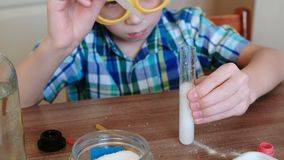 Experiments on chemistry at home.Chemical reaction with the release of gas in the test tube in the boy,s hands. Pour the. Water to test tube using pipette stock video