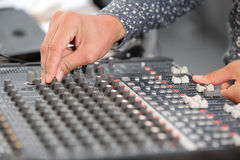An expert adjusting audio mixing console Stock Images