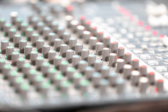 An expert adjusting audio mixing console Stock Image