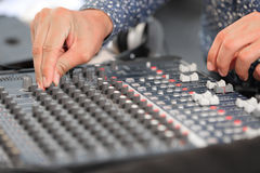 An expert adjusting audio mixing console Stock Photo
