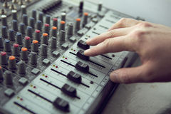 Expert adjusting audio mixing console Royalty Free Stock Photography