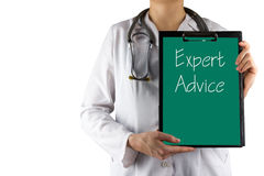 Expert advice - Female doctor's hand holding medical clipboard and stethoscope Royalty Free Stock Image