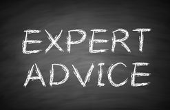 Expert advice. Text is written by white chalk on blackboard Royalty Free Stock Images