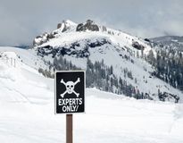 Expert area for skiing in mountains. Top or the ski resort with warning sign Stock Photo
