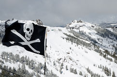 Expert area for skiing in mountains. Top or the ski resort with warning sign on the flag Stock Image