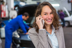 Expert in autobile working in a garage Stock Images