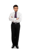 Expert Businessman or Salesman. Confident business man or salesman standing with arms folded on a white background stock image
