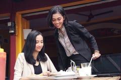 Expert businesswoman supervising in restaurant Stock Image