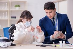 The expert criminologist working in the lab for evidence. Expert criminologist working in the lab for evidence royalty free stock photography