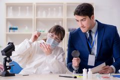 The expert criminologist working in the lab for evidence. Expert criminologist working in the lab for evidence stock images