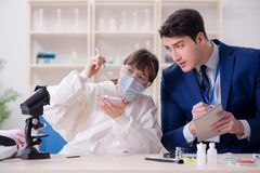 The expert criminologist working in the lab for evidence. Expert criminologist working in the lab for evidence stock photo