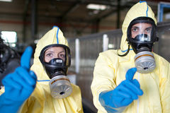 Expert disposing biohazard. Biohazard expert in yellow protection sweet disposing infested material royalty free stock photos