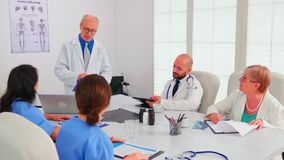 Expert doctor talking about medical technology with medical staff